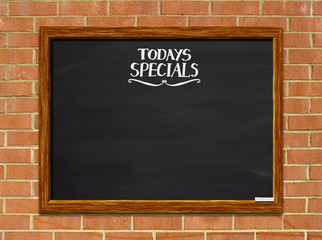 Today's Special's blackboard with red brick background.