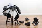 Heap of clothing on a stool and disordered shoes poster