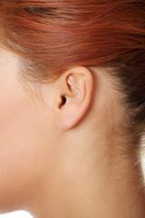 Young caucasian woman ear .