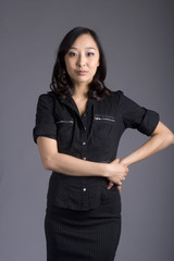 Asian Business Woman in Dark Business Attire
