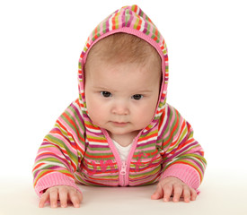 Cute baby wearing colorful sweater