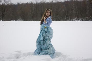 Girl sleeping in snow