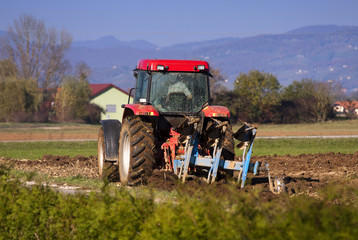 Ploughing with tractor