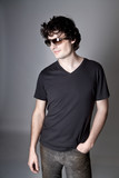 Fashion Shot of a Young Man A trendy European man poster