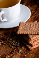 cup of fresh herbal tea and some cookies