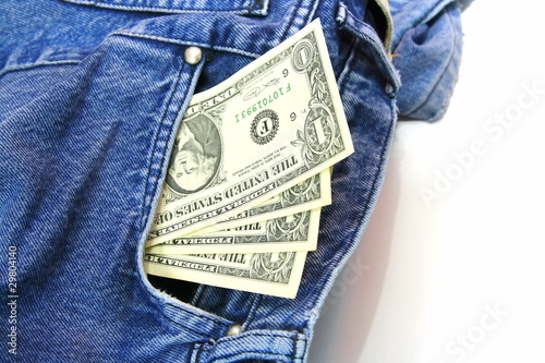 One dollar bills in jeans pocket
