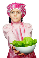 girl in an apron with the dish of lettuce