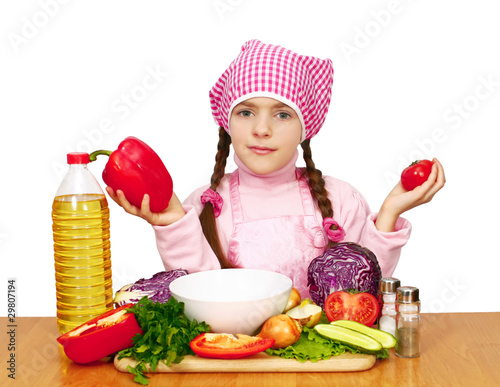 girl preparing lettuce from vegetables