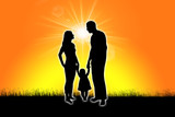 silhouette of a family at dawn