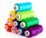 Fototapety Pyramid of many-coloured bobbins of thread isolated on white