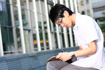 chinese man studing outdoor