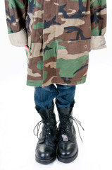 kid wearing father's military uniform