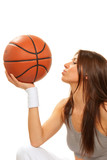 Fototapeta Basketball brunette woman player kissing ball