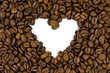 crowded coffee beans shows a heart shape