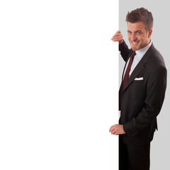 Businessman holding a blank sign in front of him