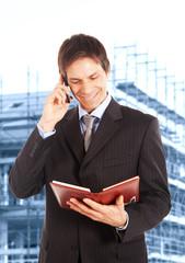 Portrait of a building contractor near a construction site