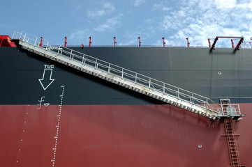 Iron ladder on a tanker ship carrying coal