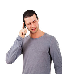 Young man talking at the phone isolated on white