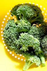 Fresh garden broccoli in yellow collander