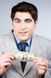 Funny man holding a  dollar
