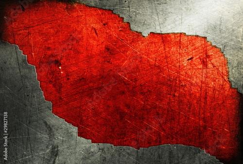 Grunge metalu talerz na czerwonym tle