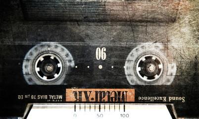 Grunge cassette in cassette deck, close up