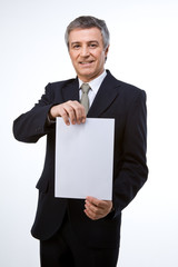 Man holding a white piece of paper