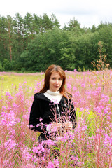 young woman  in the wild flowers field..