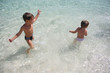 two children having fun on water