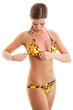 Full-length portrait of sexy young woman in leopard swimsuit