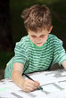 Young child drawing with a pen
