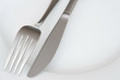 Closeup of fork and knife on a plate