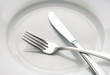 Fork and knife on a white plate