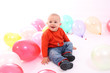 Little boy with colored balloons