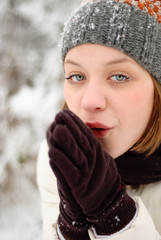 Girl's face with snow outdoors