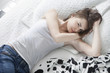 woman lying on her bed after having row with her boyfriend