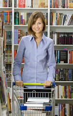 Young woman shops in a bookshop