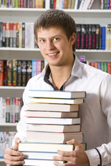 Student sitting with books in the library