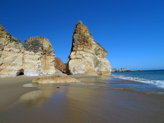 A section of the idyllic Praia de Rocha beach . Algarve region.