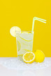 Lemonade in glass yellow background