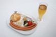 Vienna sausages with bread, salad and beer on a white background