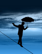 Man walking tightrope silhouette