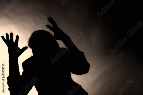 Silhouette of depressed man