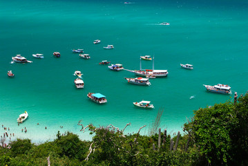 Boats over a crystalline sea in Arraial do Cabo, Brazil