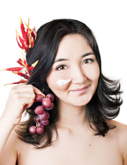 young asian women with face mask and fruits