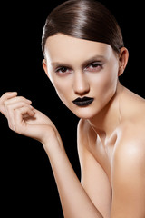 Woman with fashion slicked hairstyle, make-up & black lips
