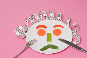 Diet Salad Face on White Plate Pink Background