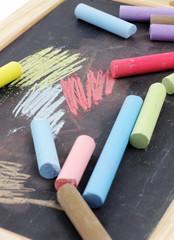 Chalks and black chalkboard