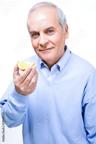 Man eating orange