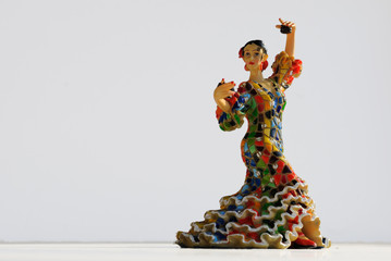 Coloful flamenco dancer with castanets